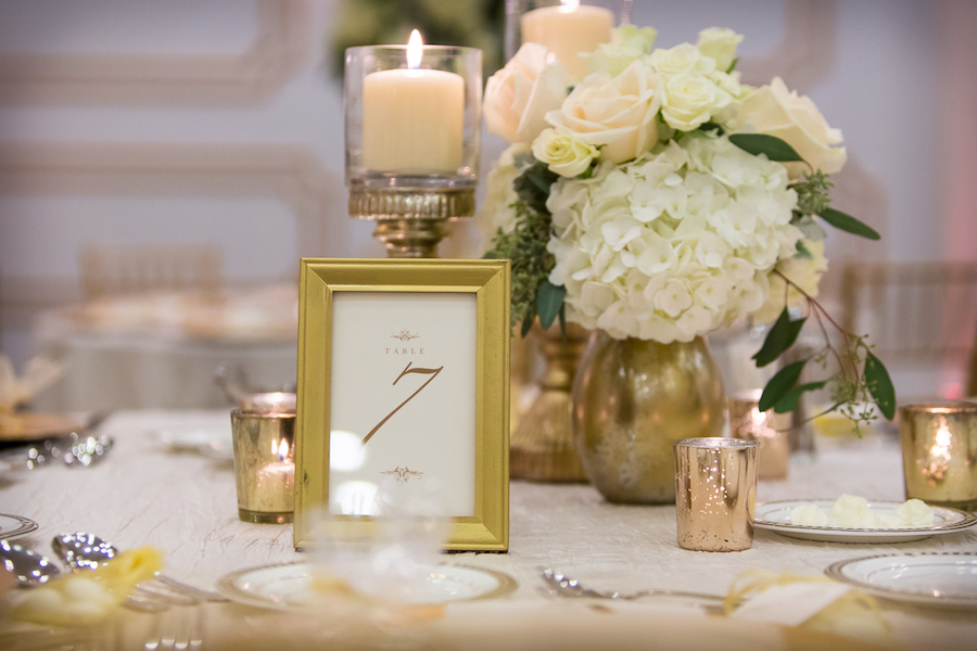 White And Ivory Floral Wedding Centerpieces And Candles On Gold