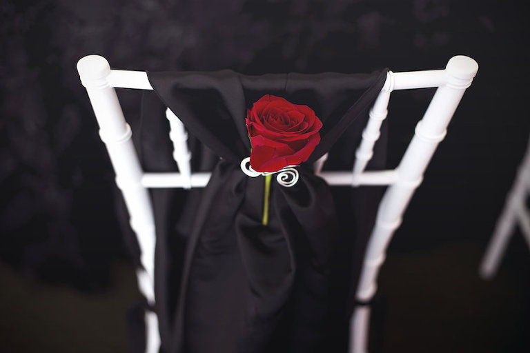 White Chiavari Chairs with Black Draping and Red Rose by Apple Blossoms Floral Design