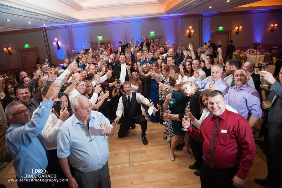 Tampa Bay Bride and Groom Group Photo with Guests at Wedding Reception | St. Petersburg Wedding DJ and Entertainment Celebrations24