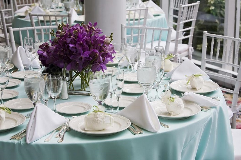 Elegant Wedding Reception Dishes and Place Setting at Tampa Bay Wedding Reception on Teal Linens Tablecloths with White Chiavari Chairs | St. Petersburg Wedding Rentals Rent-All City