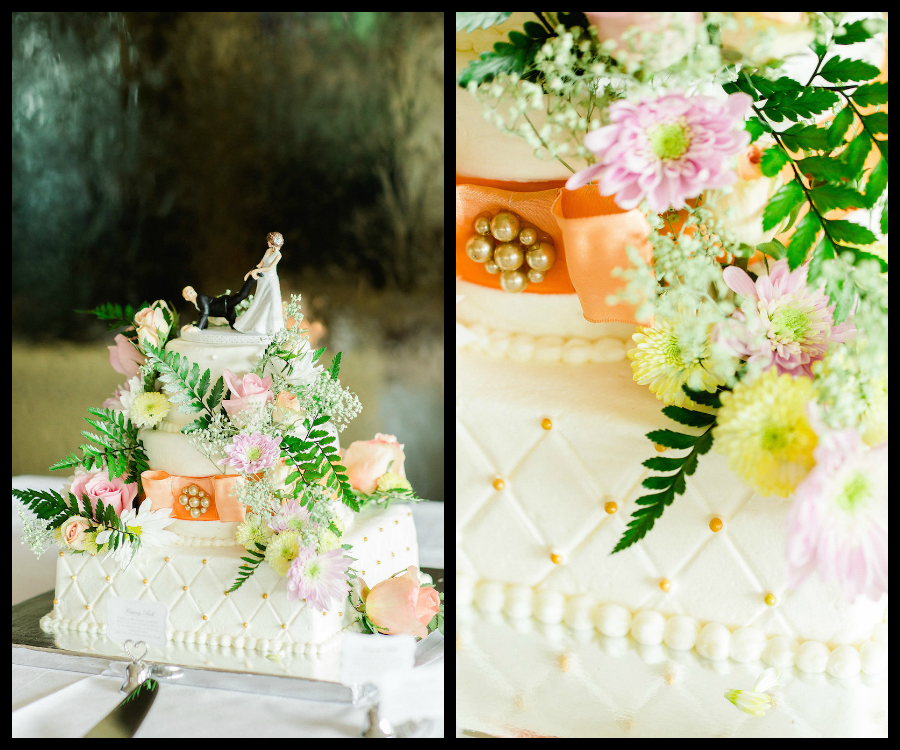 White, Wedding Cake with Cascading Purple and White Flowers and Coral Bow | Clearwater Wedding Cake Corey's Bakery