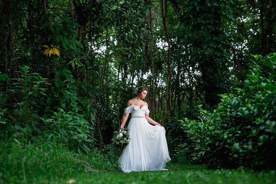 Bride wearing Amsale wedding dress from Blush Bridal Sarasota Portrait in Woods | Southern Inspired Outdoor Wedding Reception Decor Styled Shoot
