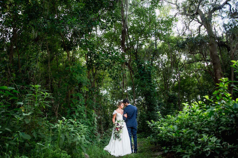Bride wearing Amsale wedding dress from Blush Bridal Sarasota and Groom Portrait | Southern Inspired Outdoor Wedding Reception Decor Styled Shoot