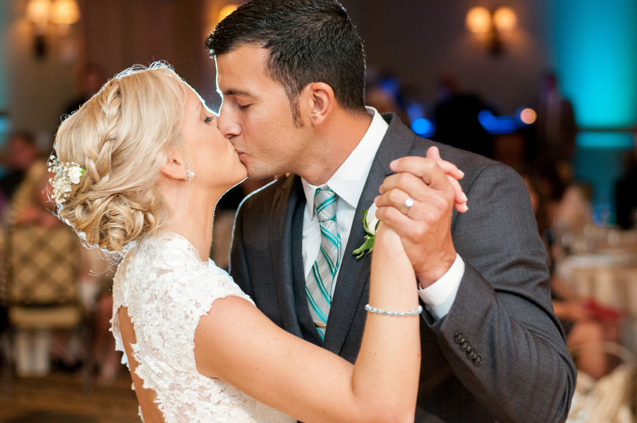 Bride and Groom Kissing During First Dance | Clearwater Beach Wedding Photographer Caroline and Evan Photography
