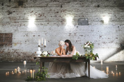 Same Sex Gay Couple at Vintage Wooden Sweetheart Table at Wedding Reception, Surrounded by Candlelight and Flowers Bohemian/Boho Styled Wedding Shoot | Tampa Wedding Photographer FotoBohemia