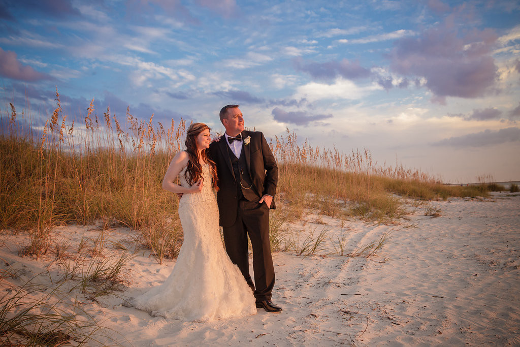 Destination Beach Bride and Groom Wedding Portrait at Sunset | Outdoor St Pete Beach Wedding at Loews Don CeSar | Kleinfeld Bridal Strapless Beaded Wedding Dress