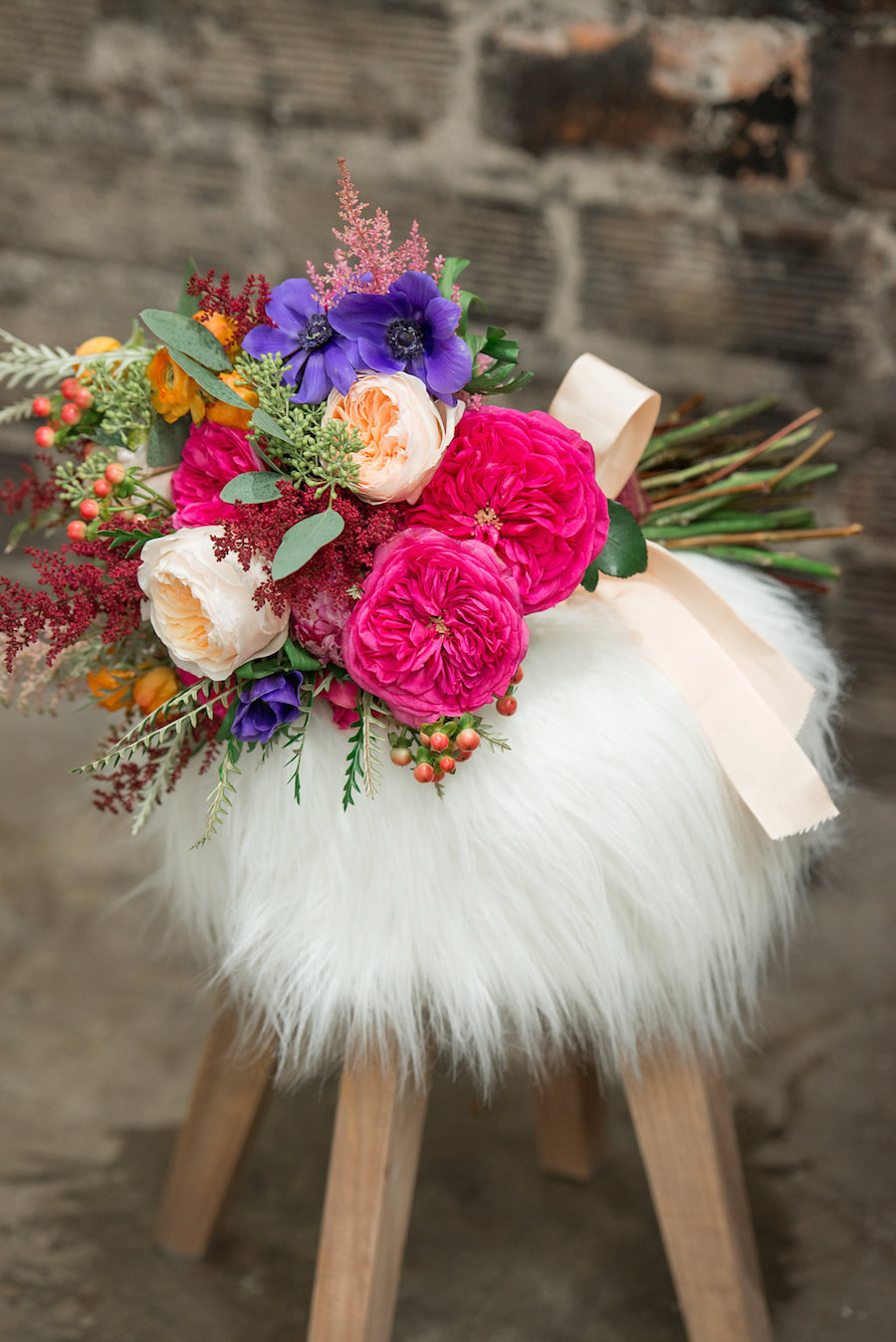 Boho Chic Garden Inspired Bouquet with Vibrant Pink and Purple Flowers with Greenery and Fur Decor Accents by Tampa Bay Florist Carrollwood Florist | Tampa Bay Wedding Photographer Artful Adventures Photography