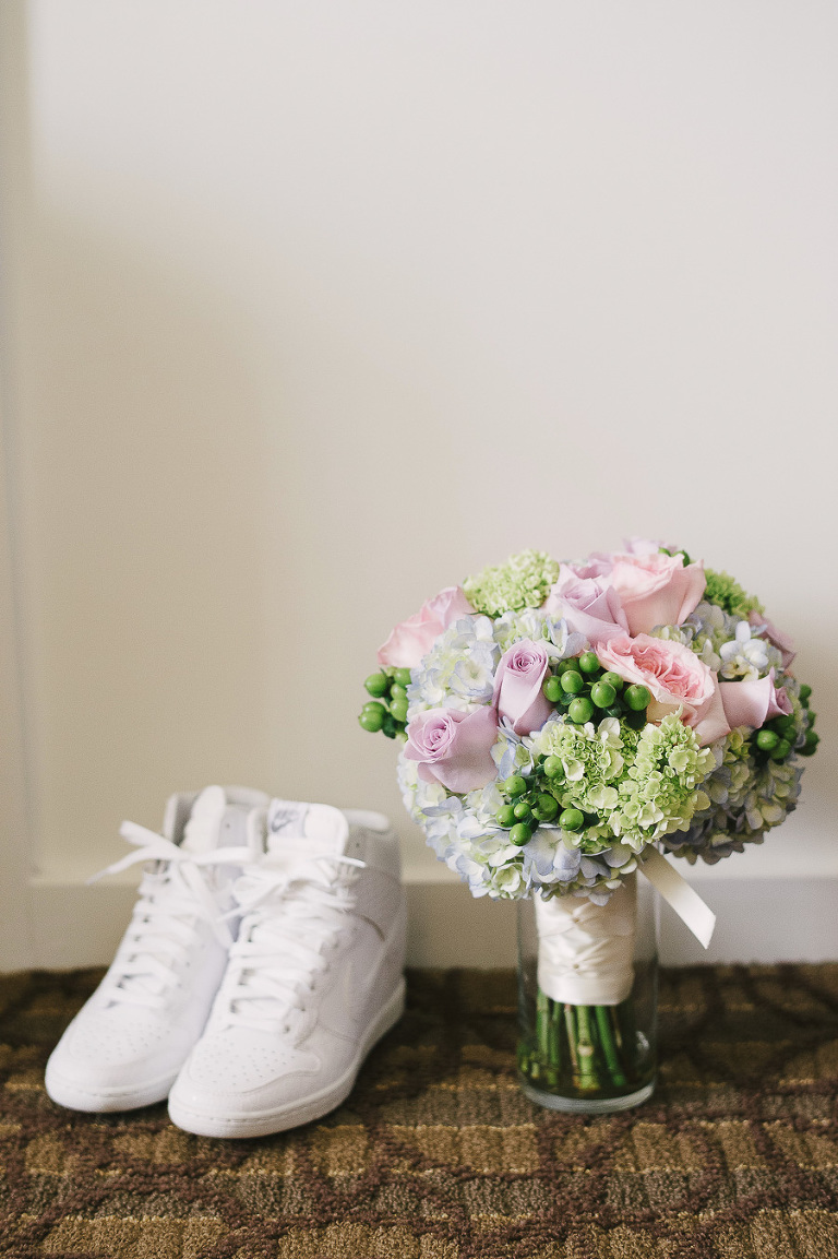 White Nike Bridal Tennis Shoes with Pink Roses and Greenery Wedding Bouquet Detail Clearwater Beach Wedding