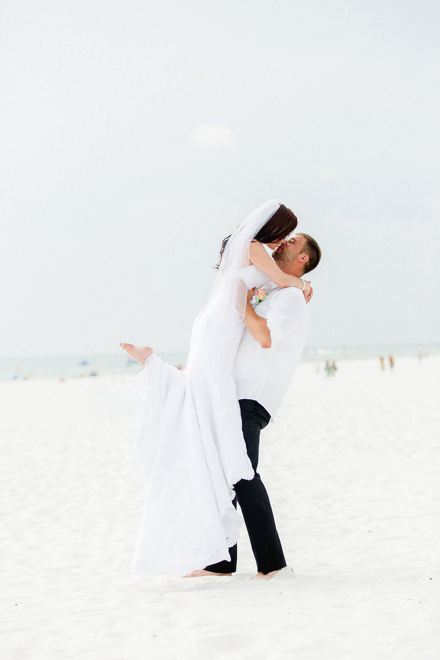 Bride and Groom Wedding Portrait Kissing On Clearwater Beach | Clearwater Beach Wedding Photographer Ailyn La Torre Photography