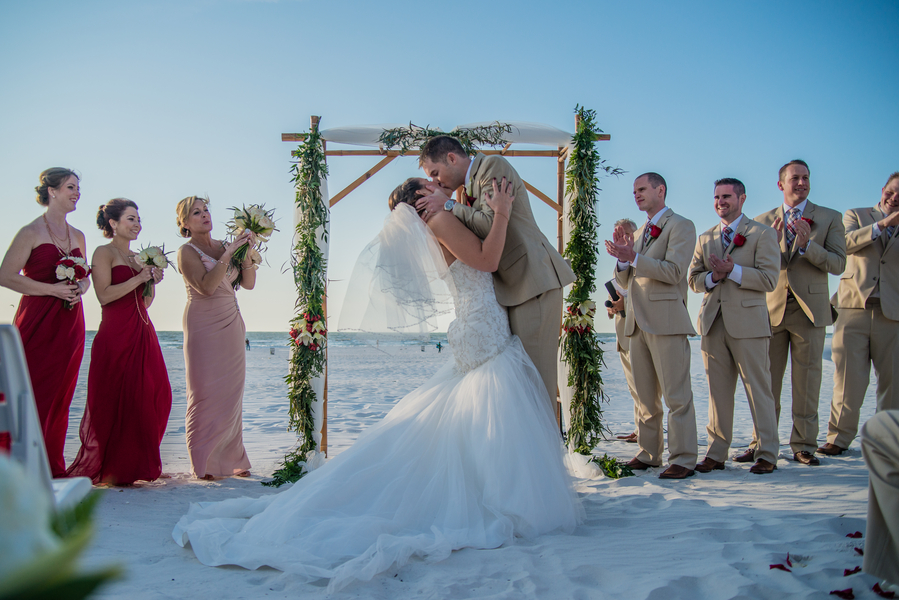 Bride and Groom Beach Wedding Ceremony Kiss at Altar | Outdoor, Hilton Clearwater Beach Waterfront Wedding Venue