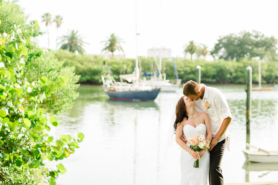Bride and Groom Outdoor Waterfront Kissing Wedding Portrait | Clearwater Beach Wedding Photographer Ailyn La Torre Photography