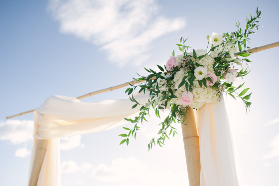 Bamboo Wedding Arch with Floral Corner Arrangement| Wedding Florals by Sarasota Florist Florist Fire