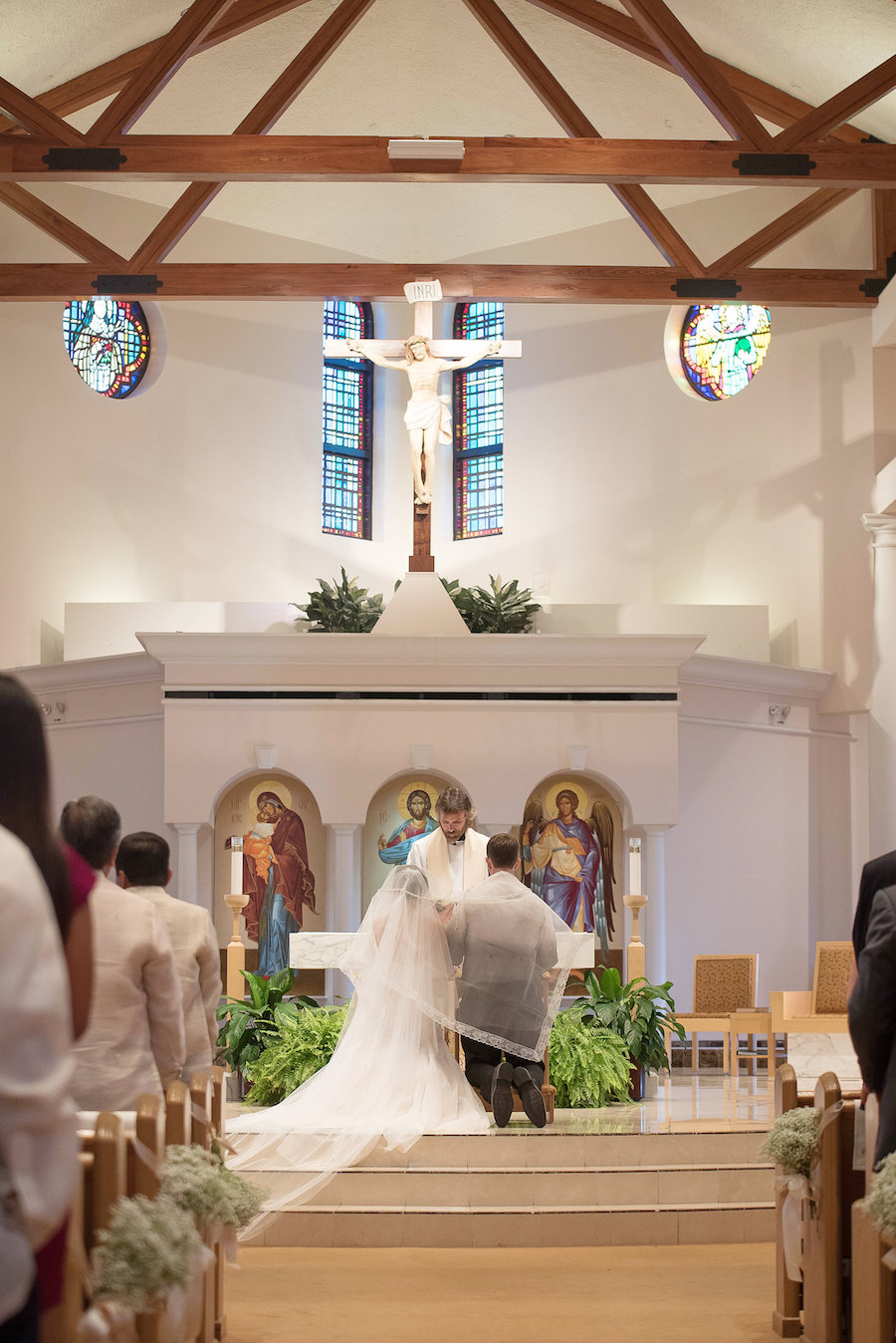 Bride and Groom During Wedding Ceremony at St. Raphael Catholic Church| Photo by Tampa Bay Wedding Photographer Kristen Marie Photography