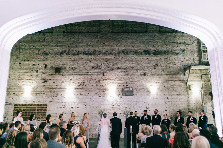 Bride and Groom Industrial Brick Wedding Ceremony at Downtown Tampa Wedding Venue The Rialto Tampa