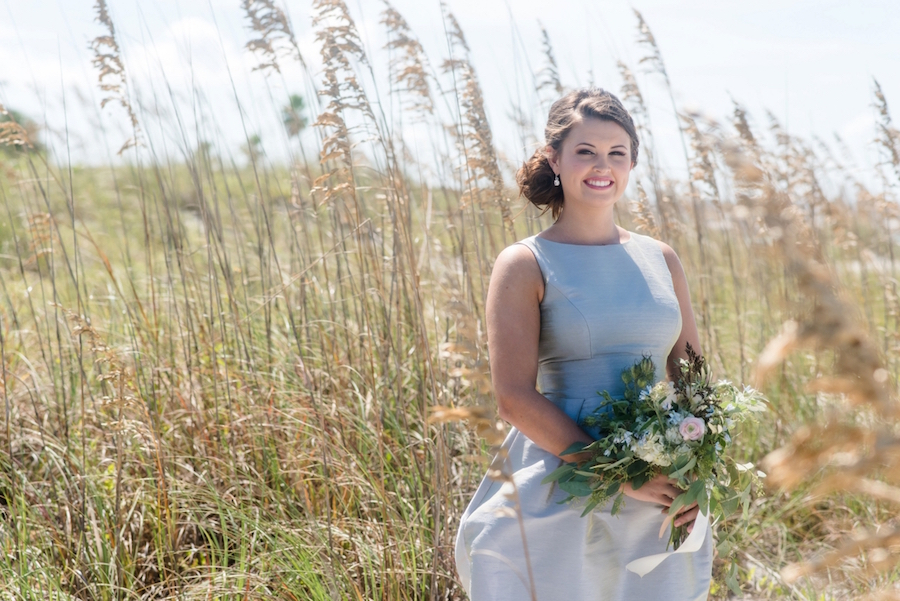 St. Pete Beach Bridesmaid in Grey Dessy Bridesmaid Dress with Lush Greenery Bouquet | Tampa Bay Wedding Photographer, Caroline & Evan Photography| Tampa Bay Wedding Hair & Makeup By Lasting Luxe Hair & Makeup