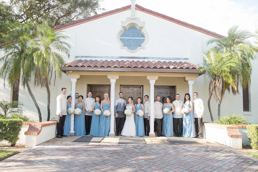 Wedding Ceremony at St. Raphael Catholic Church | Bride & Groom with Bridal Party Portrait in Dusty Blue Bridesmaids Dresses | Photo by Tampa Bay Wedding Photographer Kristen Marie Photography