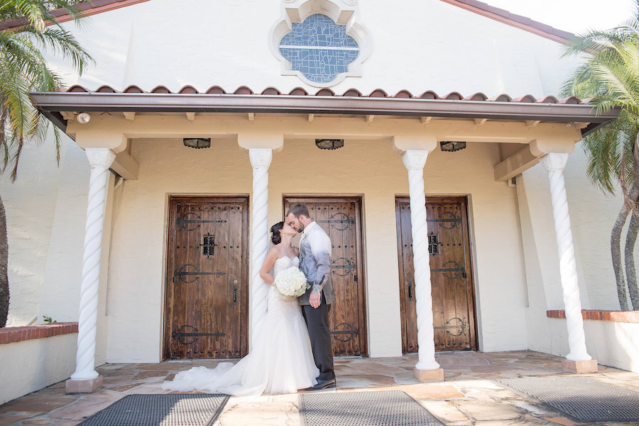 Portrait of Bride and Groom Wedding Kiss at St. Raphael Catholic Church| Photo by Tampa Bay Wedding Photographer Kristen Marie Photography