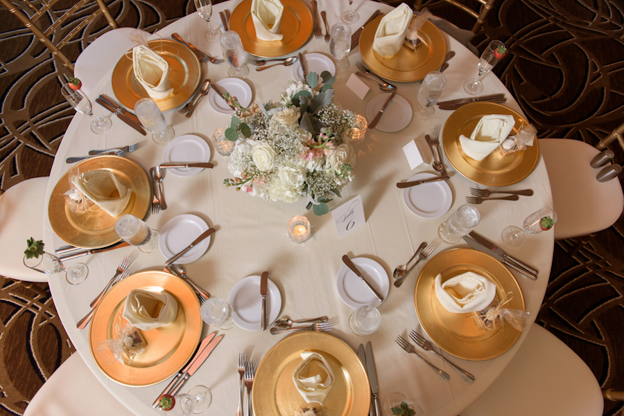 Elegant Tampa Wedding Reception Table Decor with Gold Chargers and Ivory and Pink Floral Centerpieces | Tampa Wedding Venue Tampa Marriott Waterside
