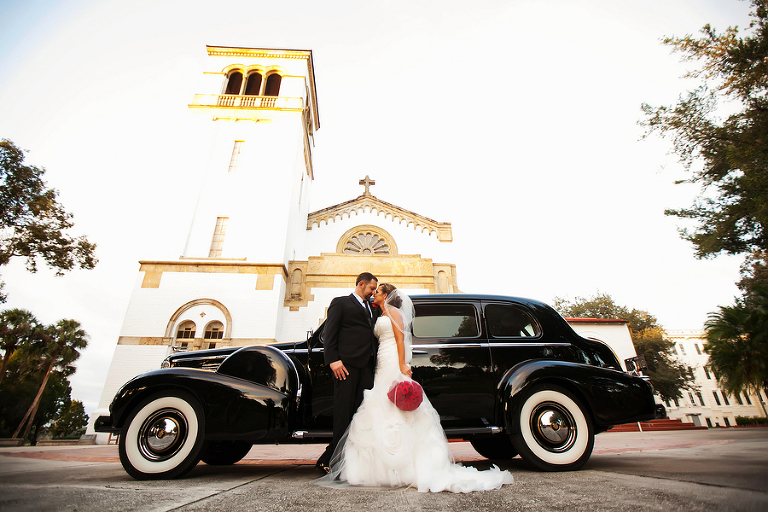 Wedding Portrait of Bride and Groom with Vintage Car at Tampa Bay Wedding Ceremony Venue St. Leo Abbey Church| Photo by Tampa Bay Wedding Photographer Limelight Photography
