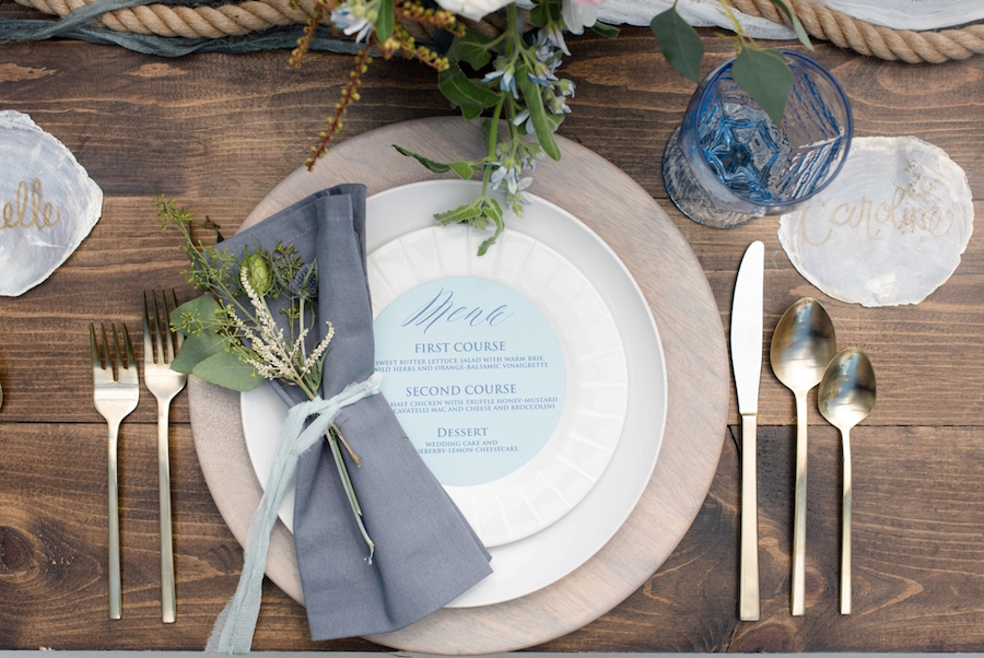 Coastal Inspired Wedding Menu and Place Setting Design with Nautical Floral Accent and Wooden Chargers on Farm Table | Tampa Bay Wedding Photographer, Caroline & Evan Photography