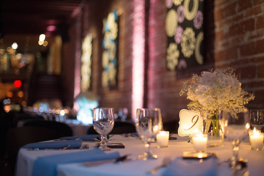 Reception Decor with Dusty Blue Accents and White Centerpieces at downtown St. Pete Wedding Venue NOVA 535| Photo by Tampa Bay Wedding Photographer Kristen Marie Photography