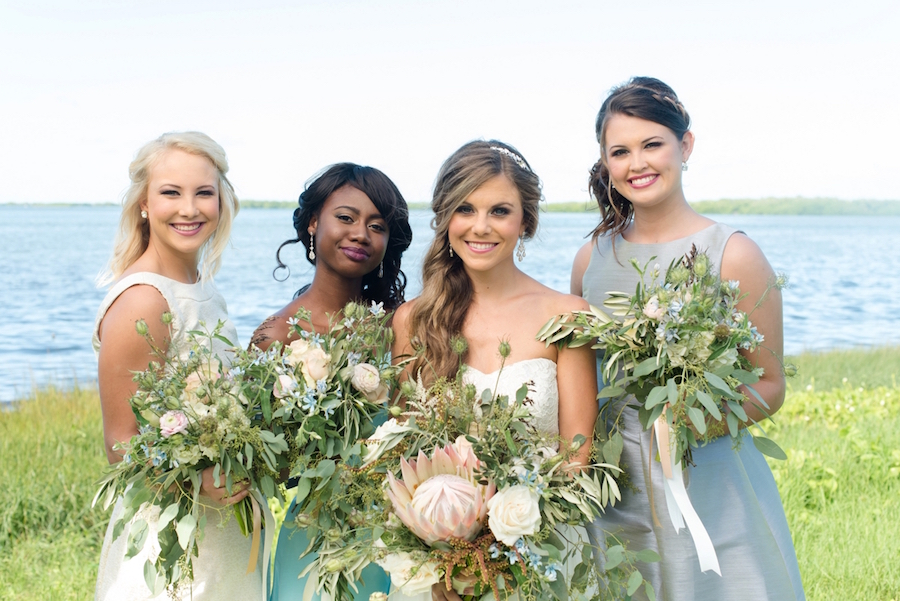 Unique Light Pastel Pink and Blue Wedding Bouquet | Wedding Portrait, Bride with Bridesmaids in Grey and White Dessy Bridal Gowns at Beach Wedding | Tampa Bay Wedding Photographer, Caroline & Evan Photography| Tampa Bay Wedding Hair & Makeup By Lasting Luxe Hair & Makeup