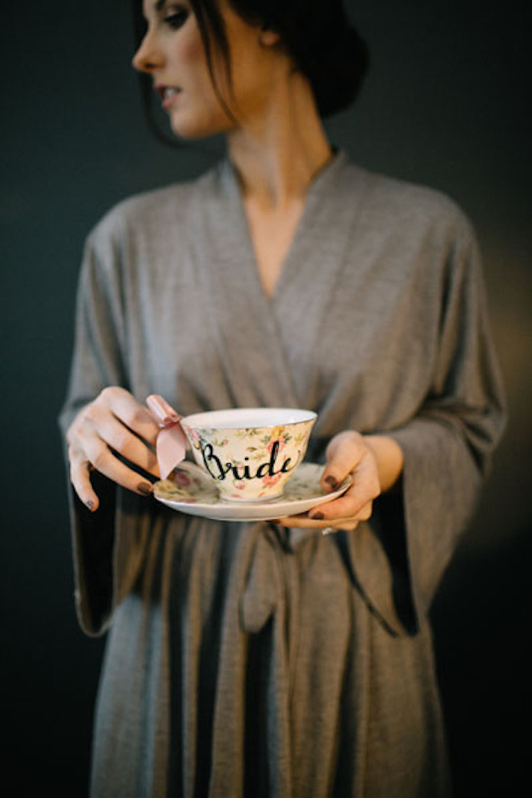 Getting Ready Details: Bridal Wedding Portrait in Robe Holding Bride Tea Cup