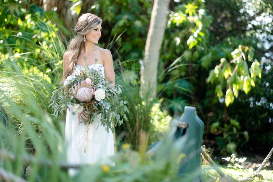 Bridal Wedding Day Portrait in Strapless Chiffon Gown | Lush Greenery Wedding Bouquet with Proteas | St. Pete Wedding Photographer | Caroline & Evan Photography| Tampa Bay Wedding Hair & Makeup By Lasting Luxe Hair & Makeup