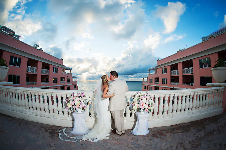 Bride and Groom Kissing Wedding Portrait, Terrace of the Clearwater Beach Hyatt Regency Hotel | Clearwater Beach Wedding Photographer Limelight Photograph