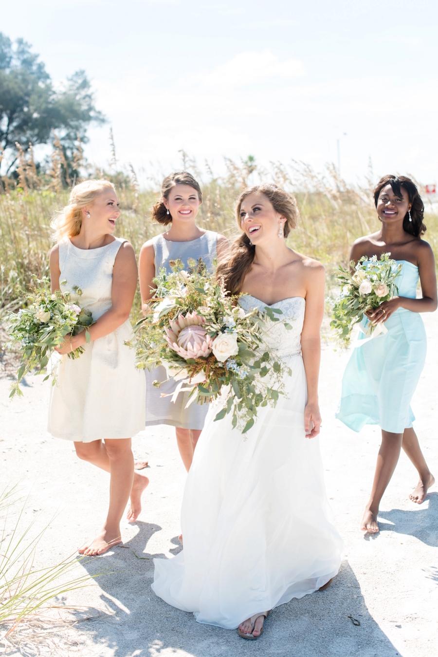 St. Pete Beach Coastal Wedding Portrait, Bride with Bridesmaid in Dessy Bridal Gowns at Beach Wedding| Tampa Bay Wedding Photographer: Caroline & Evan Photography | Tampa Bay Wedding Hair & Makeup By Lasting Luxe Hair & Makeup
