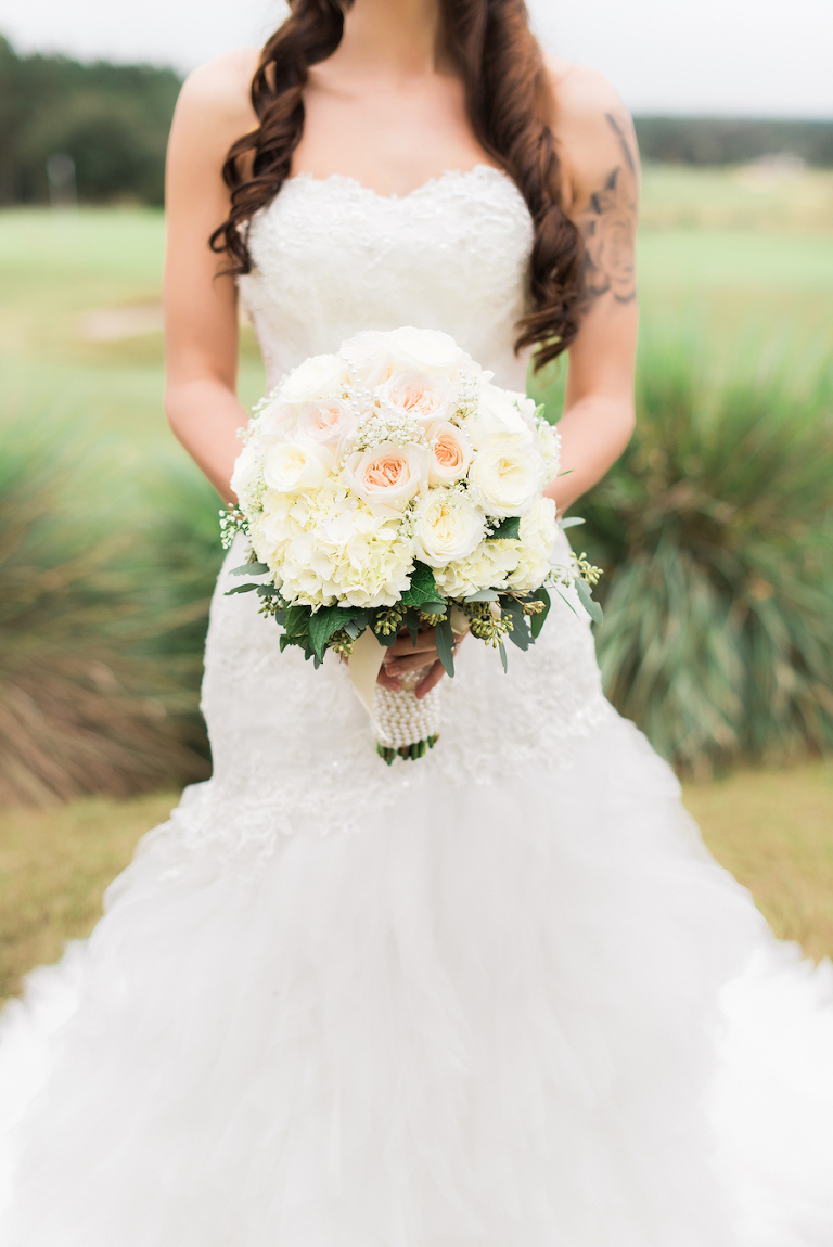 utdoor, Bridal Wedding Portrait in Ivory, Lace Strapless Wedding Gown and Ivory and Blush Pink Wedding Bouquet of Flowers