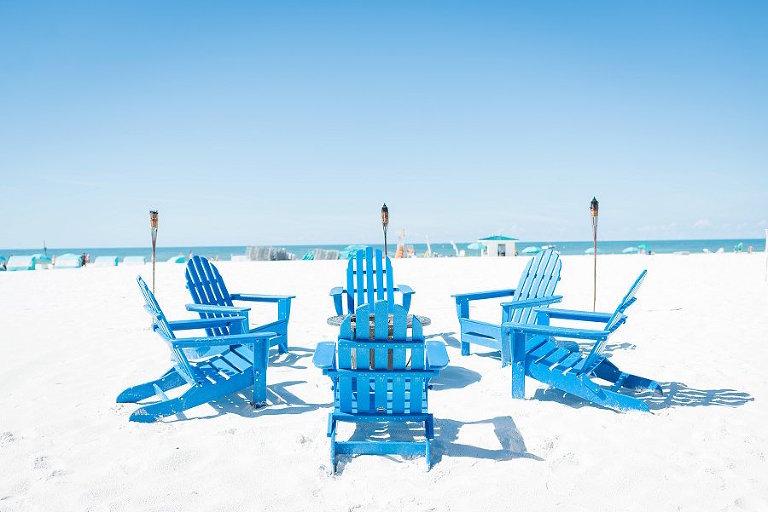 Clearwater Beach Wedding Blue Beach Chairs and Tiki Torches