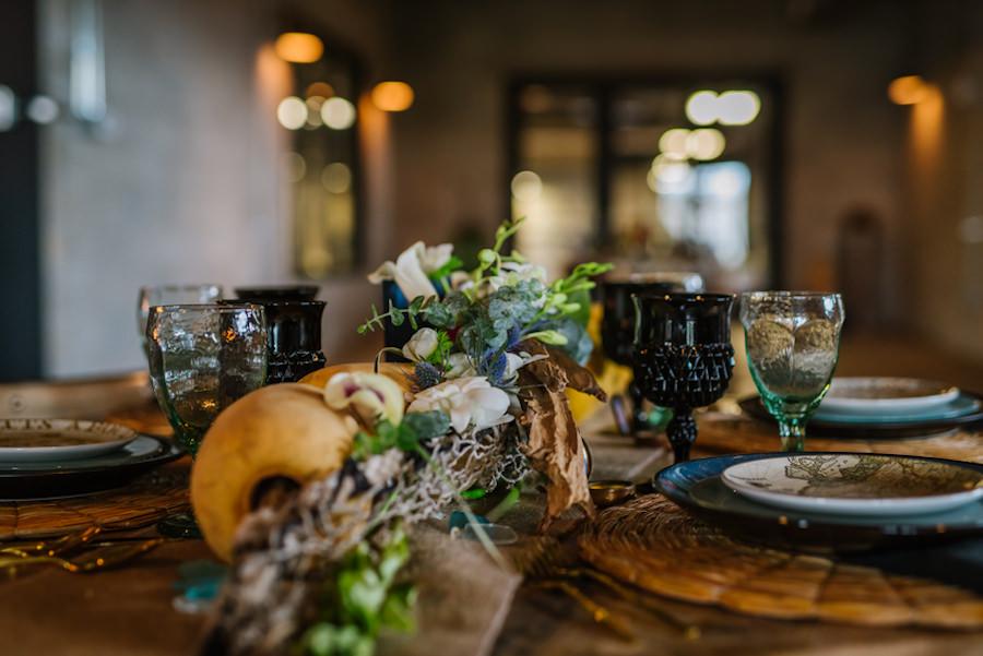 Ybor City Wedding Reception Decor with Black Glassware, Nautical Plates, Floral Garland and Buoy