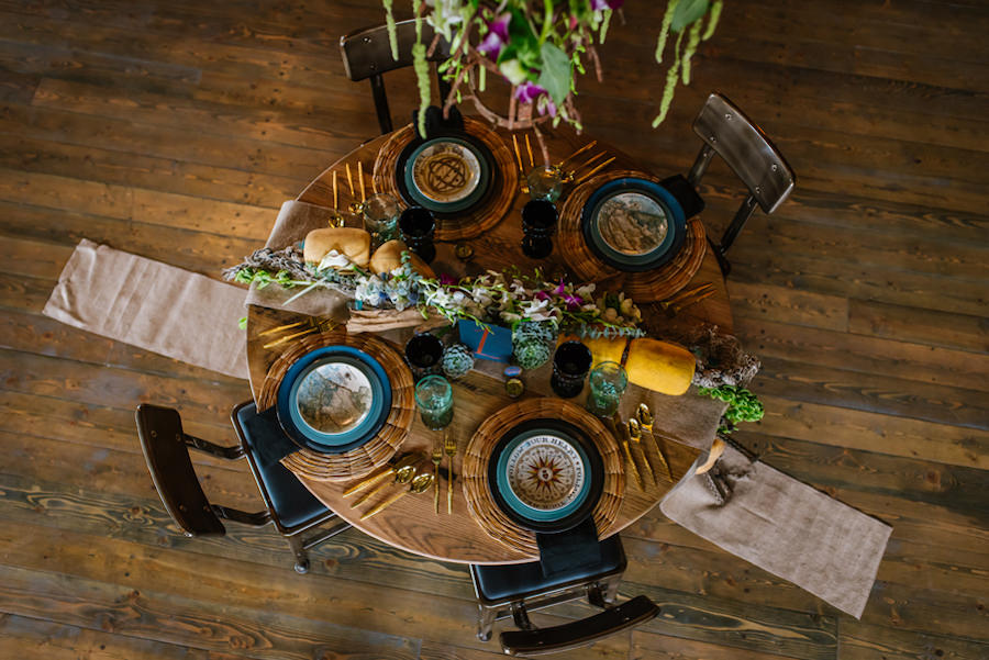 Ybor City Wedding Reception Table Decor with Nautical Inspired Place Setting Tableware, Gold Utensils, Floral Garland and Buoy | Ybor Wedding Venue Coppertail Brewing Co