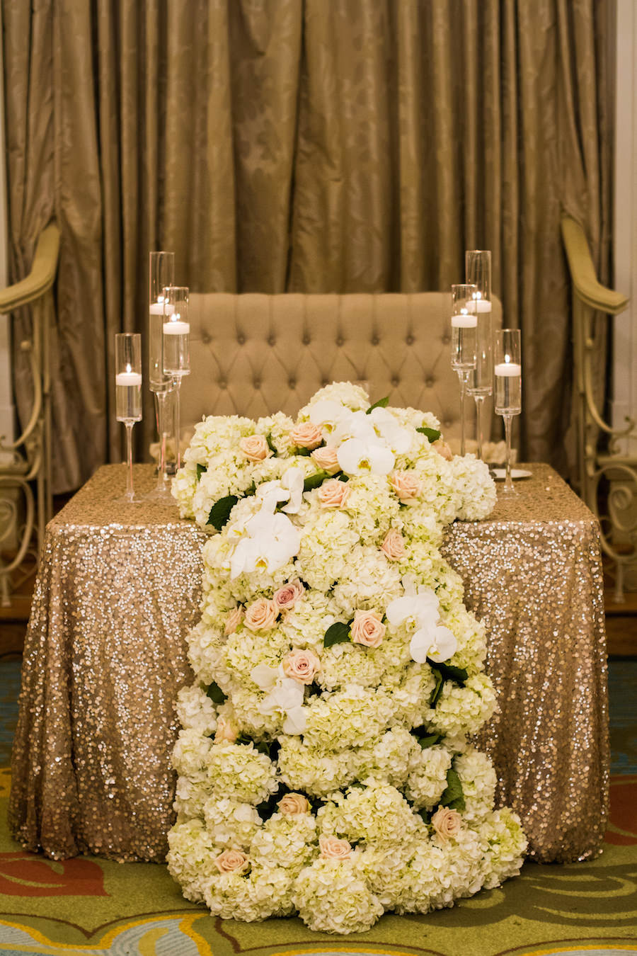 Wedding Reception Decor   Bride and Groom Sweetheart Table with Gold Sequin Table Linen and Cascading Ivory and Blush Floral Garland