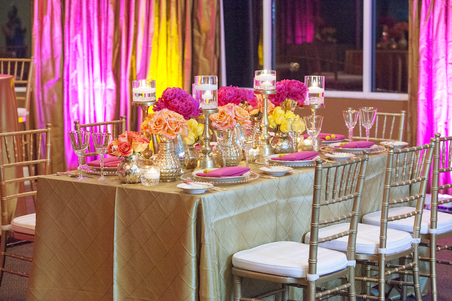 St. Petersburg Indian Wedding Reception Table Decor with Pink and Yellow Flower Centerpieces Gold Linens and Candles   St. Petersburg Wedding Florist Iza's Flowers