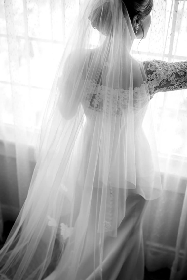 Bridal Wedding Portrait in Lace, White Wedding Gown and Chapel Length Veil