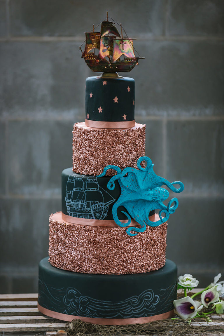 Black and Gold 5 Tiered Nautical Inspired Wedding Cake with Pirate Ship and Octopus Details | Tampa Wedding Cake Chefin Parties