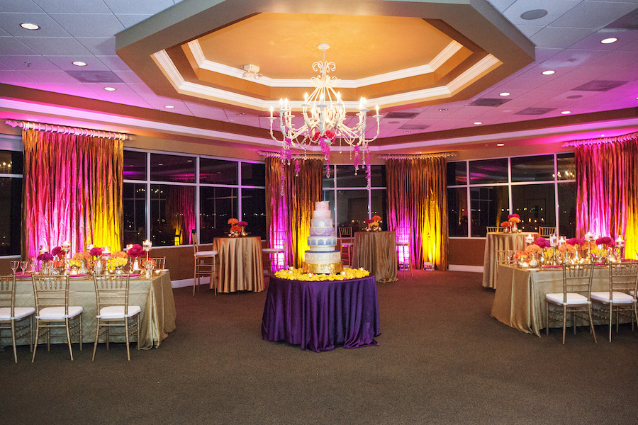 Indian Wedding Reception with Gold and Pink Centerpieces and Purple Wedding Cake | St. Petersburg Wedding Florist Iza's Flowers | Waterfront St. Pete Wedding Venue Isla del Sol Yacht and Country Club