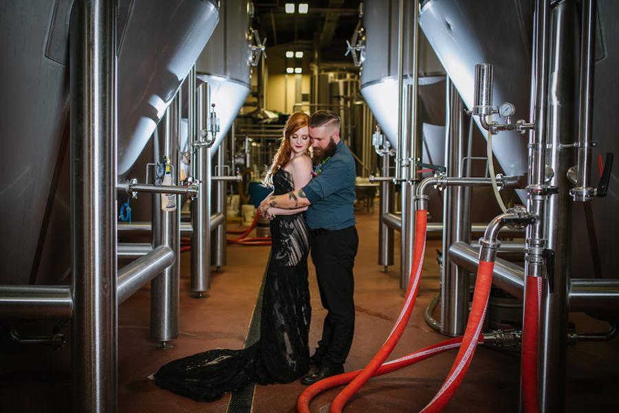 Bridal and Groom Industrial, Brewery Wedding Portrait in Black Wedding Gown| Ybor Wedding Venue Coppertail Brewing Co