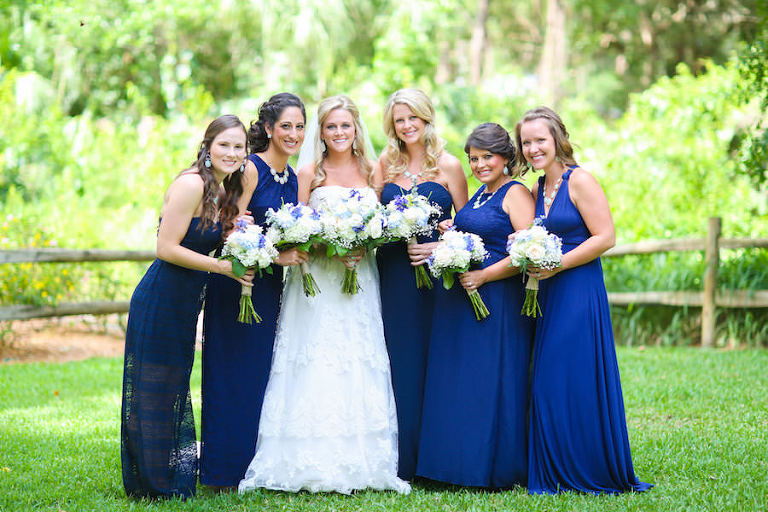 Bride and Bridesmaids Bridal Wedding Portrait with Ivory, Strapless Wedding Gown and Blue Bridesmaids Dresses with White and Purple Wedding Bouquets