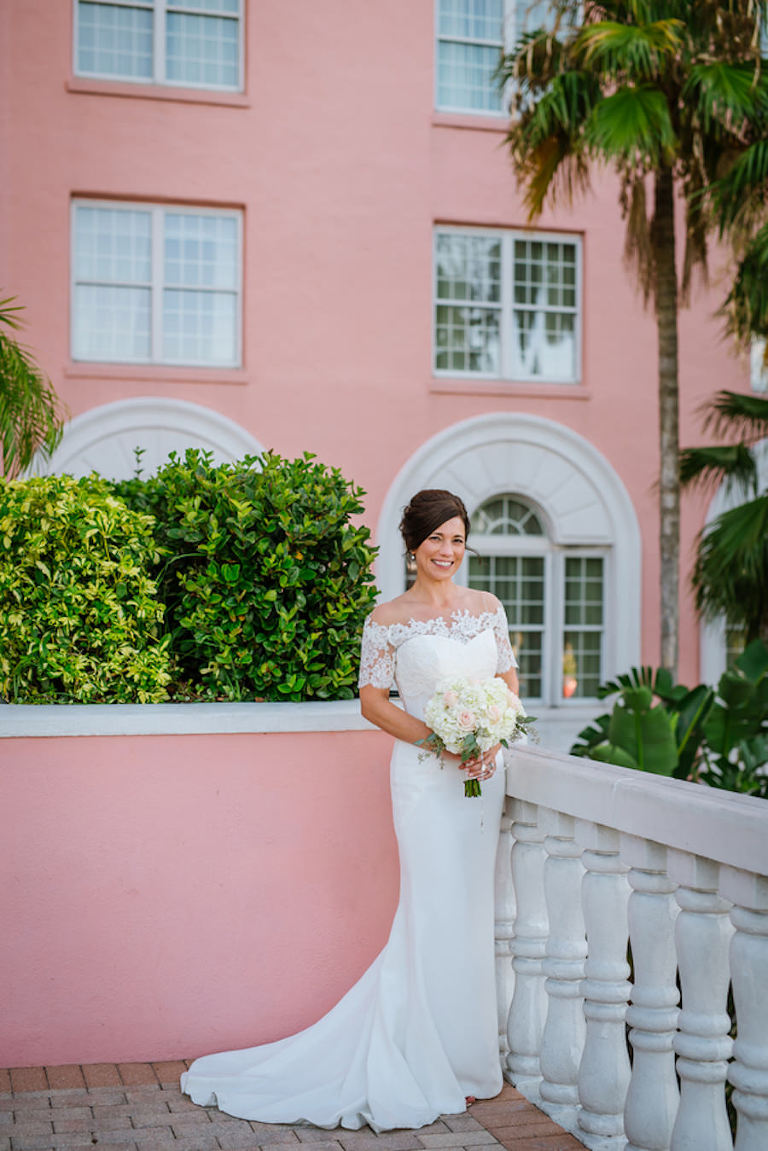 Outdoor, Bridal Wedding Portrait in Off the Shoulder, White, Lace Wedding Gown with Ivory and Pink Wedding Bouquet of Flowers | St. Pete Beach Hair and Makeup Lasting Luxe