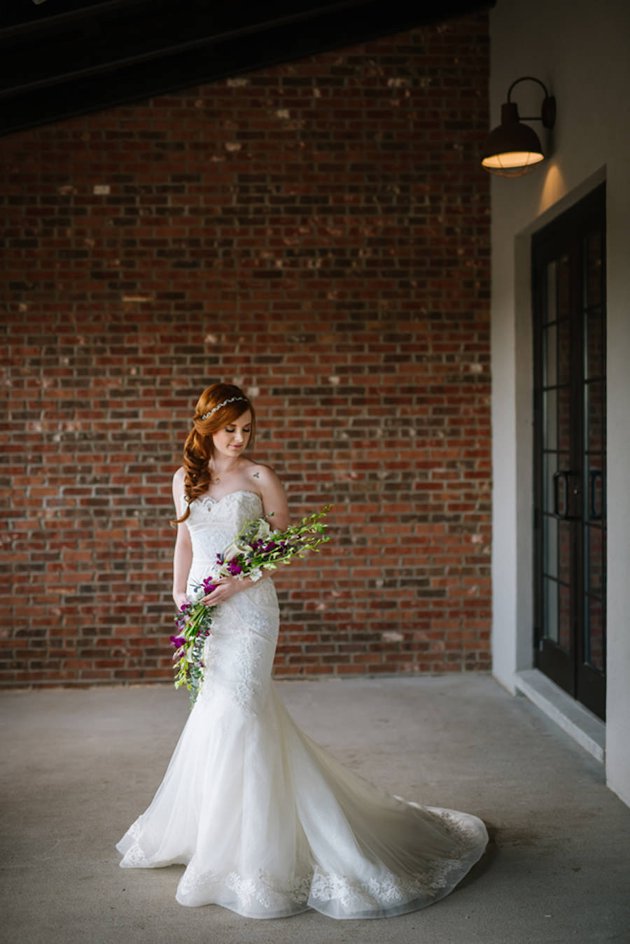 Ybor City Bridal Wedding Portrait in White, Strapless Lace Wedding Dress and Purple and Green Floral Wedding Bouquet | Coppertail Brewing Co