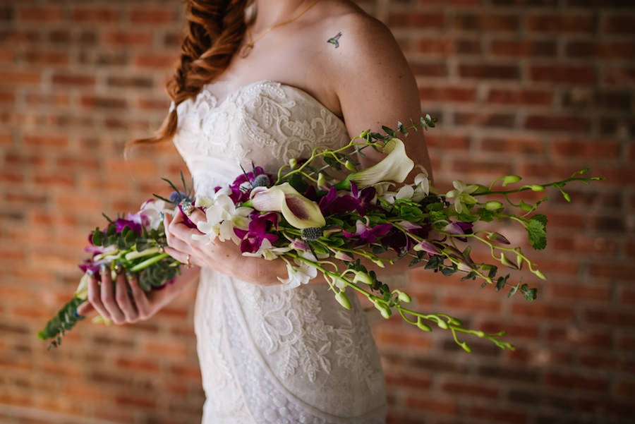 Ybor City Bridal Wedding Portrait in White, Strapless Lace Wedding Dress and Purple and Green Floral Wedding Bouquet