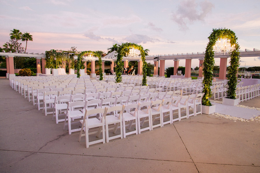 Outdoor Wedding Ceremony Decor with Green, Hanging Garland Archways and Chandeliers   St. Petersburg Wedding Venue The Renaissance Vinoy Hotel