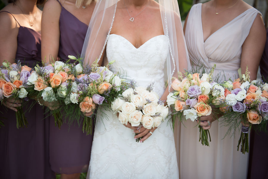 Bride and Bridesmaids Peach and Purple Wedding Bouquet Flowers with Purple Bella Bridesmaids Dresses