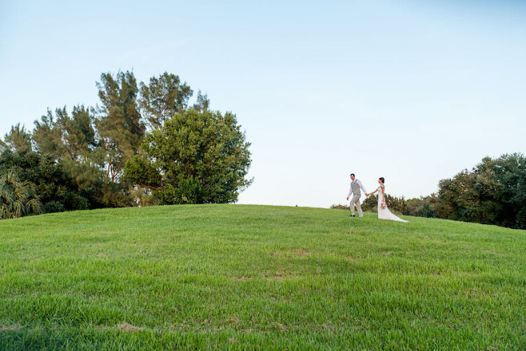 Florida Landscape Wedding Portrait in Grassy Field | Clearwater Wedding Photographer Caroline and Evan Photography