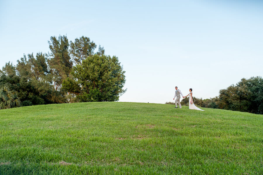 Wedding Portrait in Grassy Field   Clearwater Wedding Photographer Caroline and Evan Photography