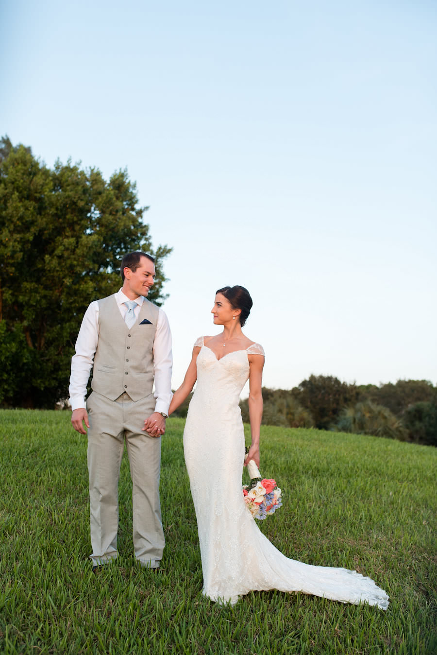 Bridal Wedding Day Portrait of Bride in Wedding Dress and Groom in Suit with Vest in a Grassy Field   Clearwater Wedding Photographer Caroline and Evan Photography