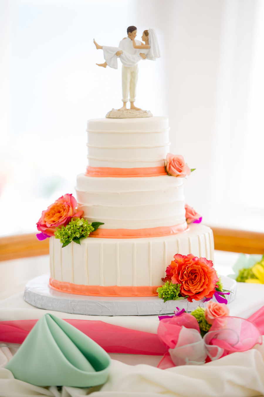 Three Tiered Wedding Cake with Coral Accent with Bright Coral and Pink Floral Details and Beach Wedding Cake Topper  St. Pete Wedding Photographer Andi Diamond Photography